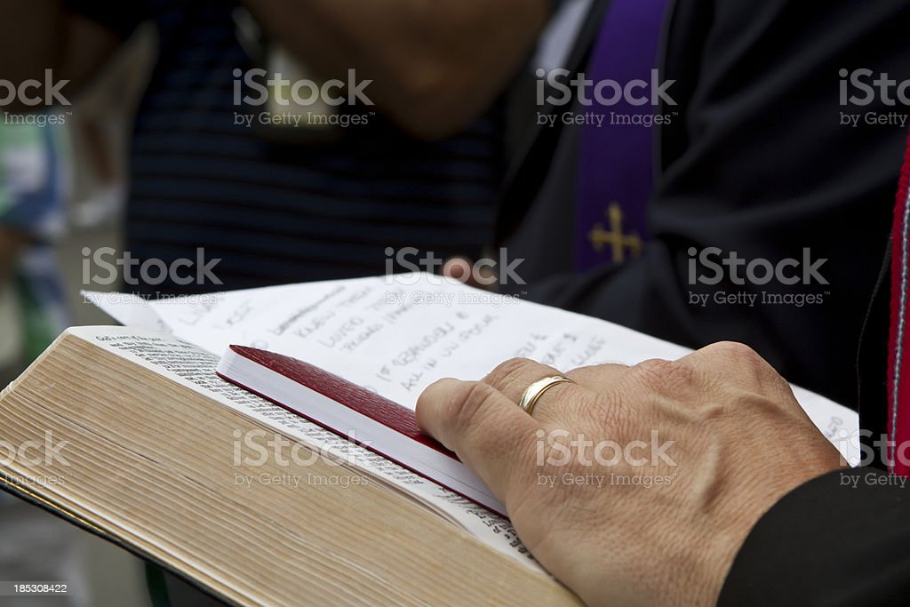 Religion Priest Human Hand With Bible royalty-free stock photo