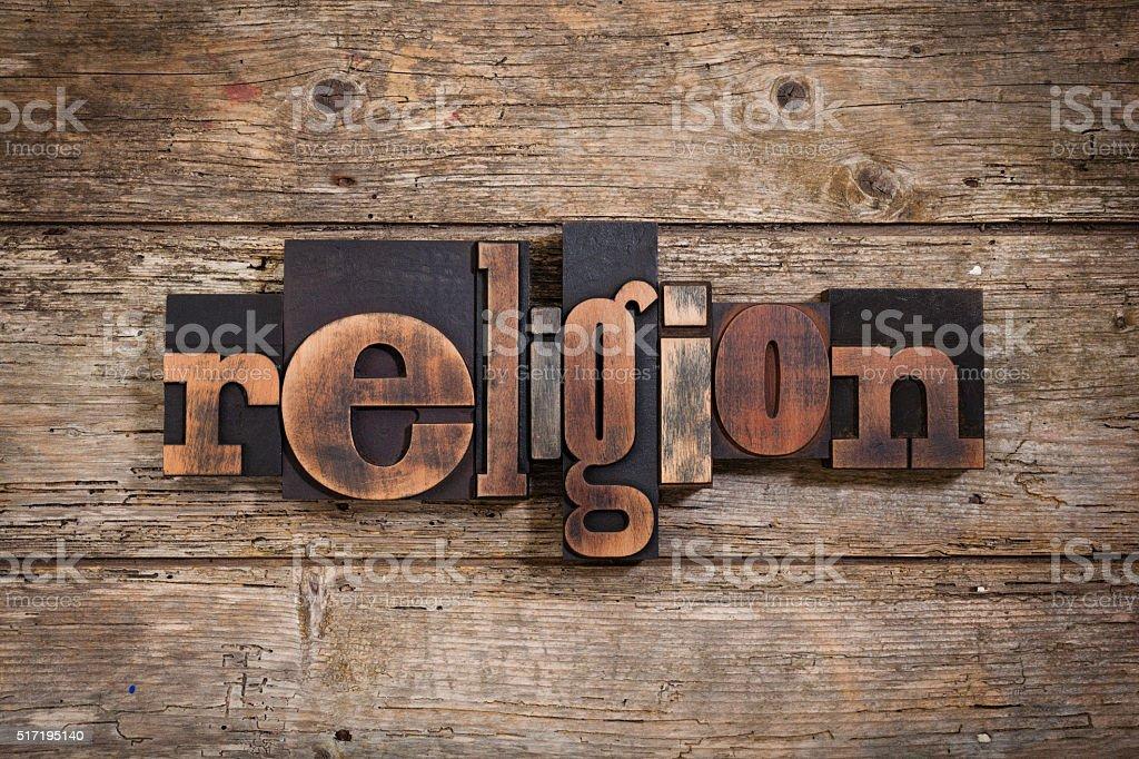 religion written with letterpress type stock photo