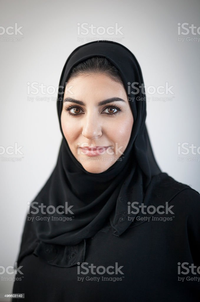 Religious Arab Woman with Light Vignetted Background stock photo