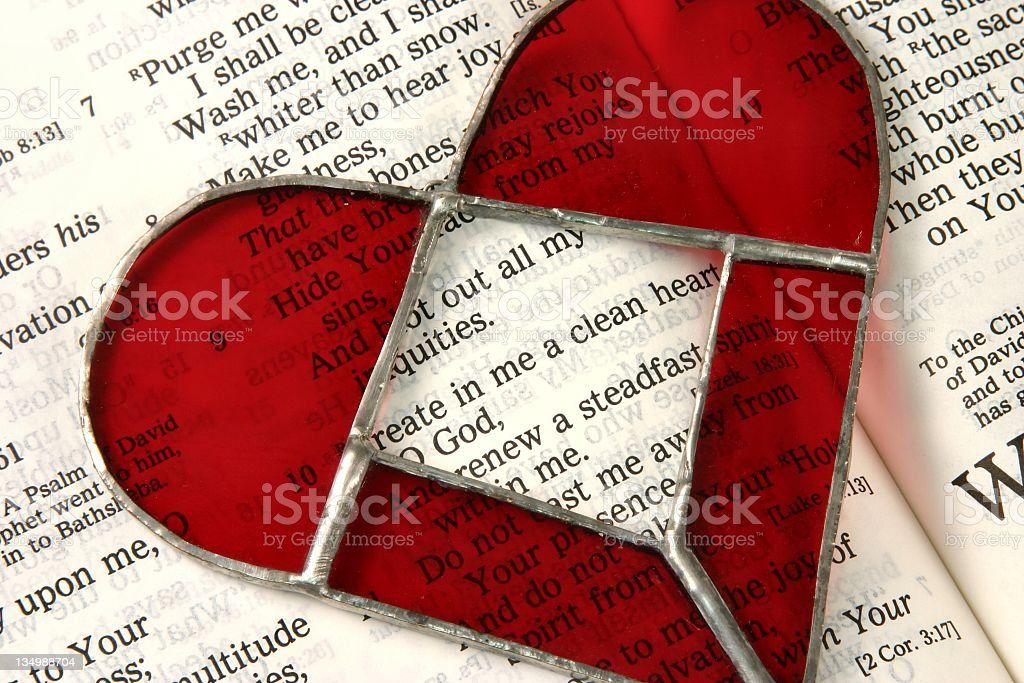 Religious: Bible scripture of Psalm 51 and Stained glass heart stock photo