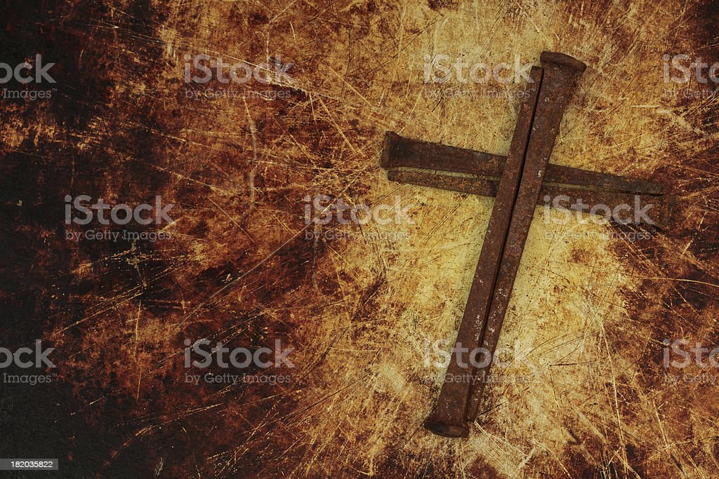 Religious: brown Cross made of Rusty Nails stock photo