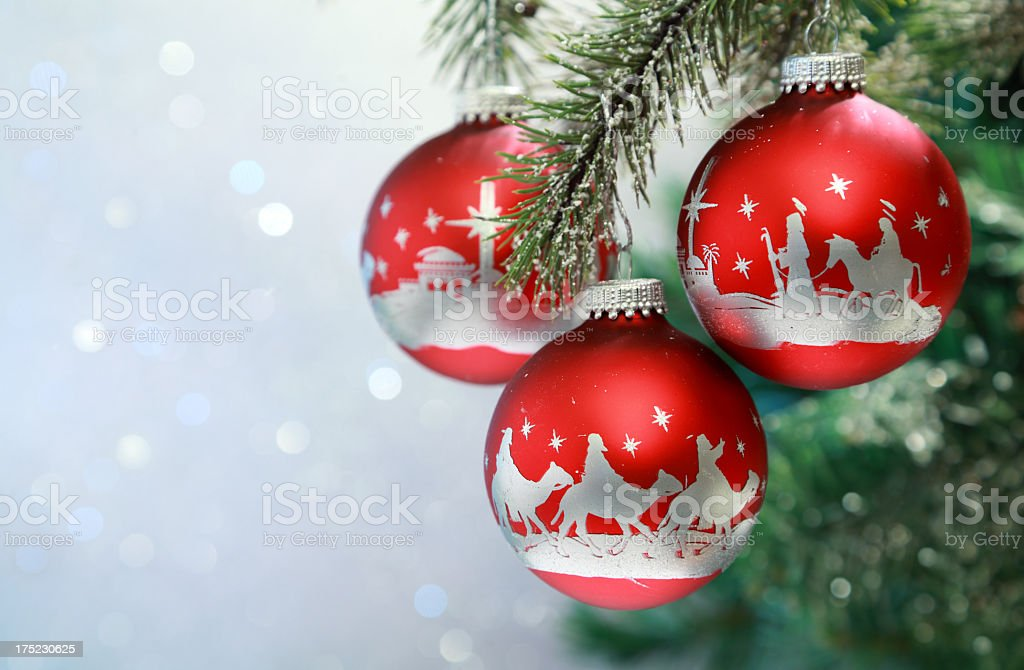 Religious: Christmas Nativity Scene on red Ornaments stock photo