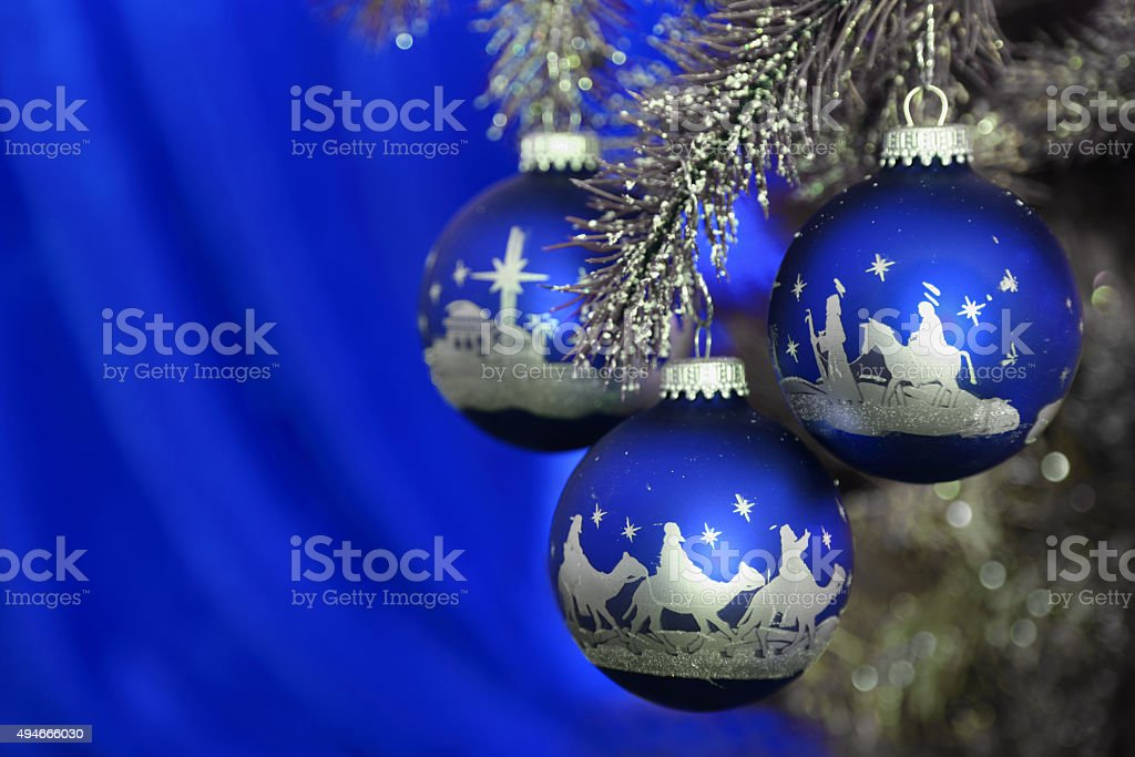 Religious: Christmas Nativity Scene on three blue and silver ornaments stock photo