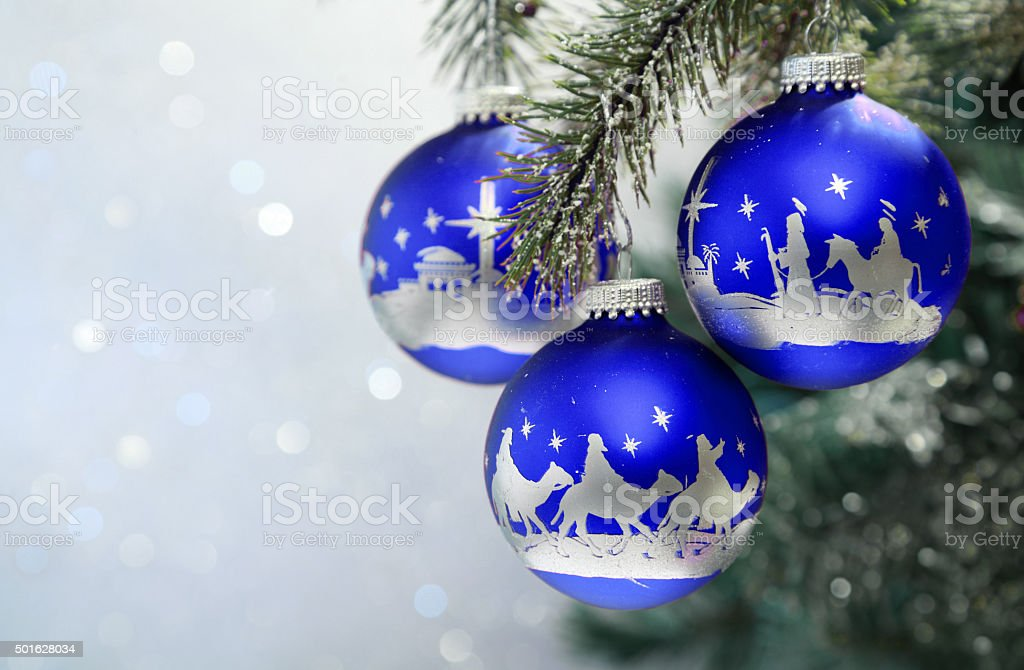 Religious: Christmas Nativity Scene on three blue ornaments stock photo