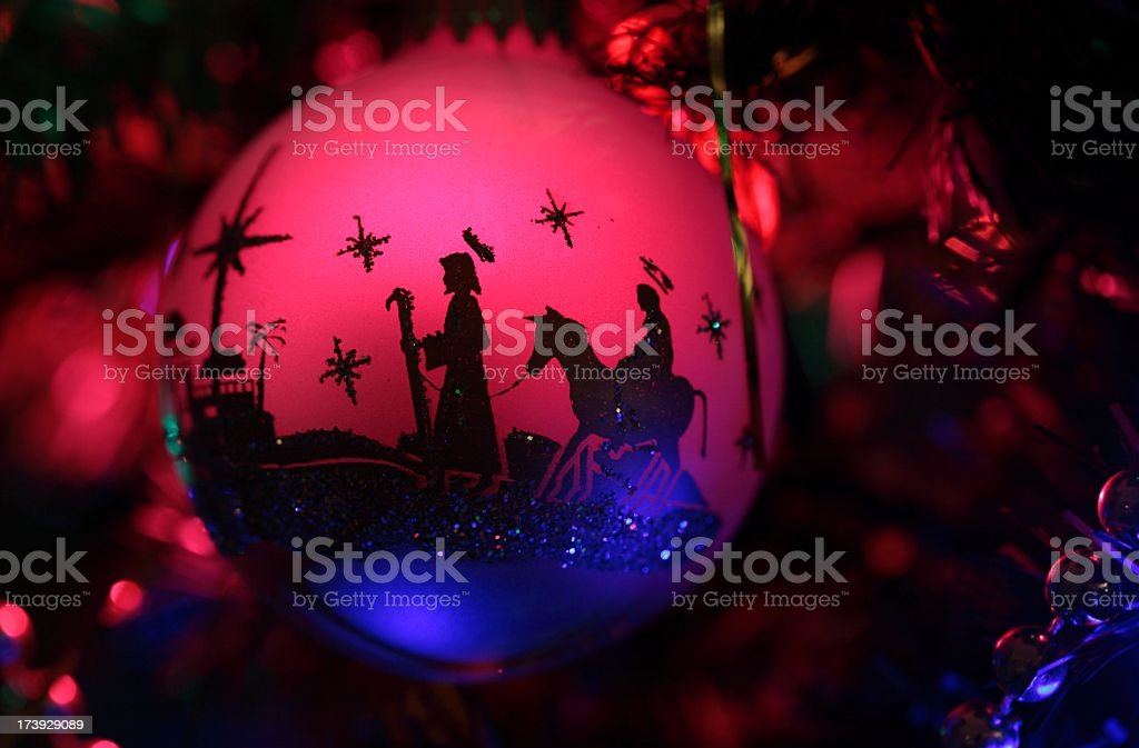 Religious: Christmas Nativity Silhouette in red on ornament royalty-free stock photo