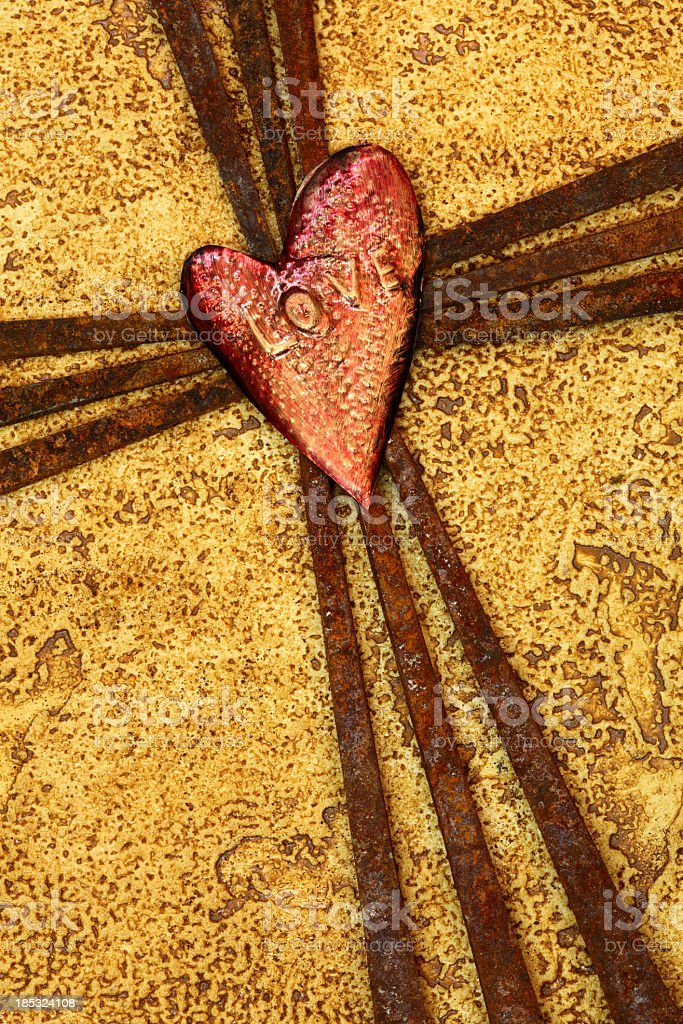 Religious: Cross of Rusty Nails with Heart says love stock photo