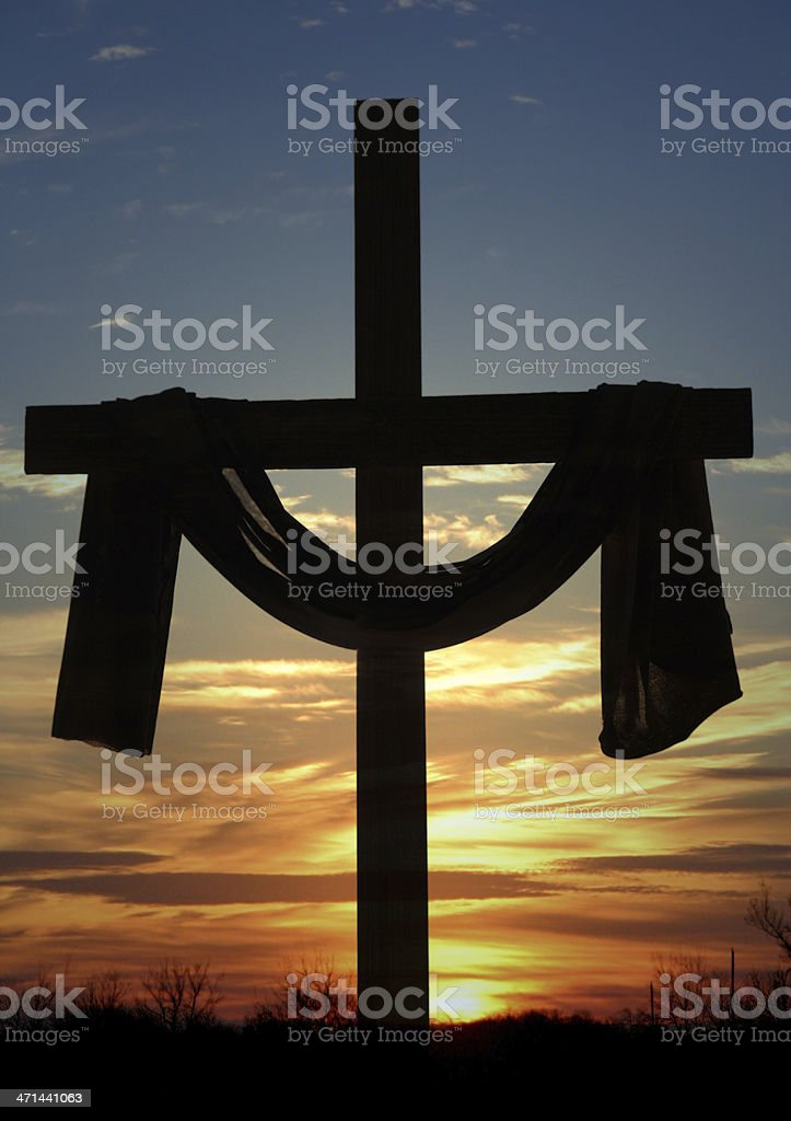 Religious: Draped Cross Silhouette at Dawn or Sunset stock photo