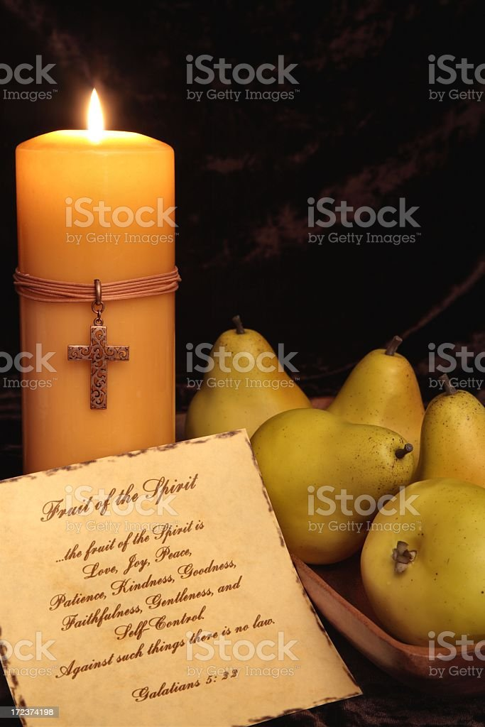 Religious: Fruit of the Spirit scripture with candle and pears royalty-free stock photo