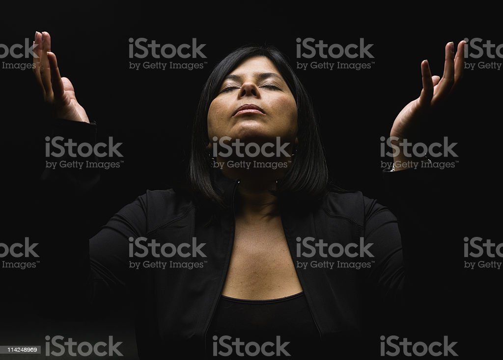 Religious hispanic lady stock photo