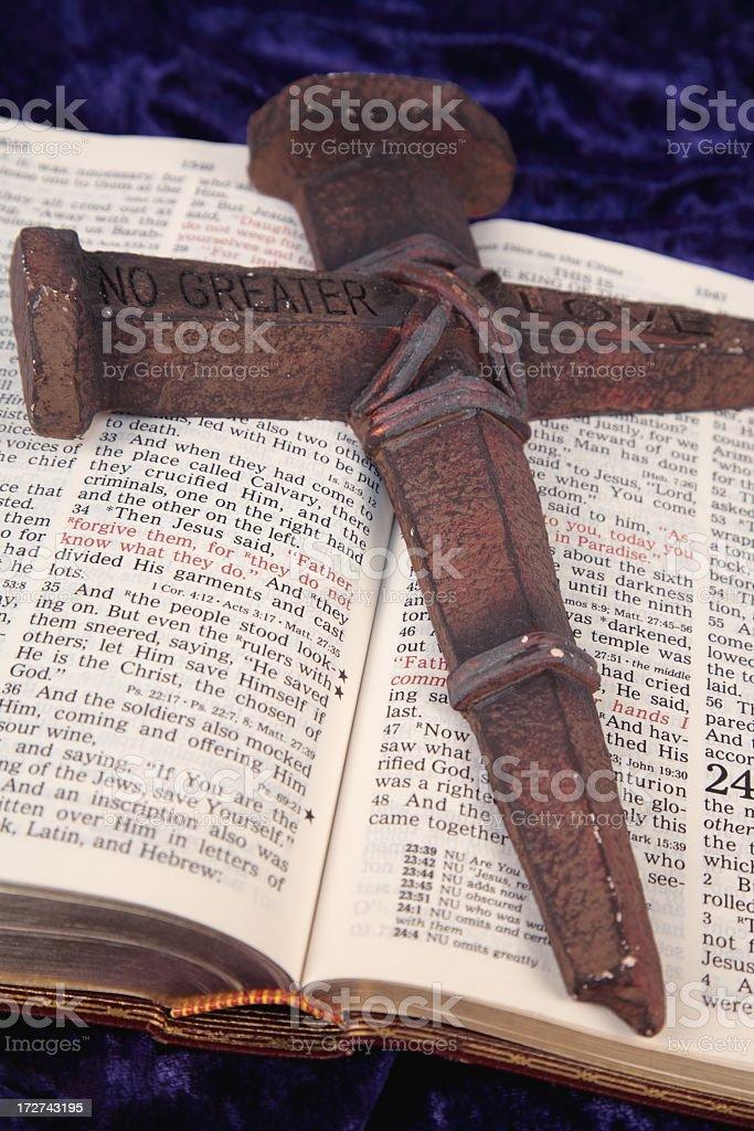 Religious: Jesus' Crucifixion Luke 23 Bible scripture with nail cross royalty-free stock photo