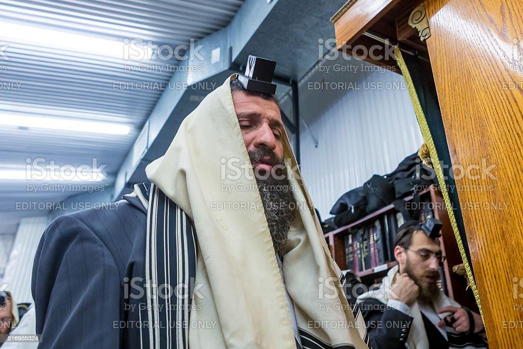 Religious jewish men pray at the Ohel stock photo
