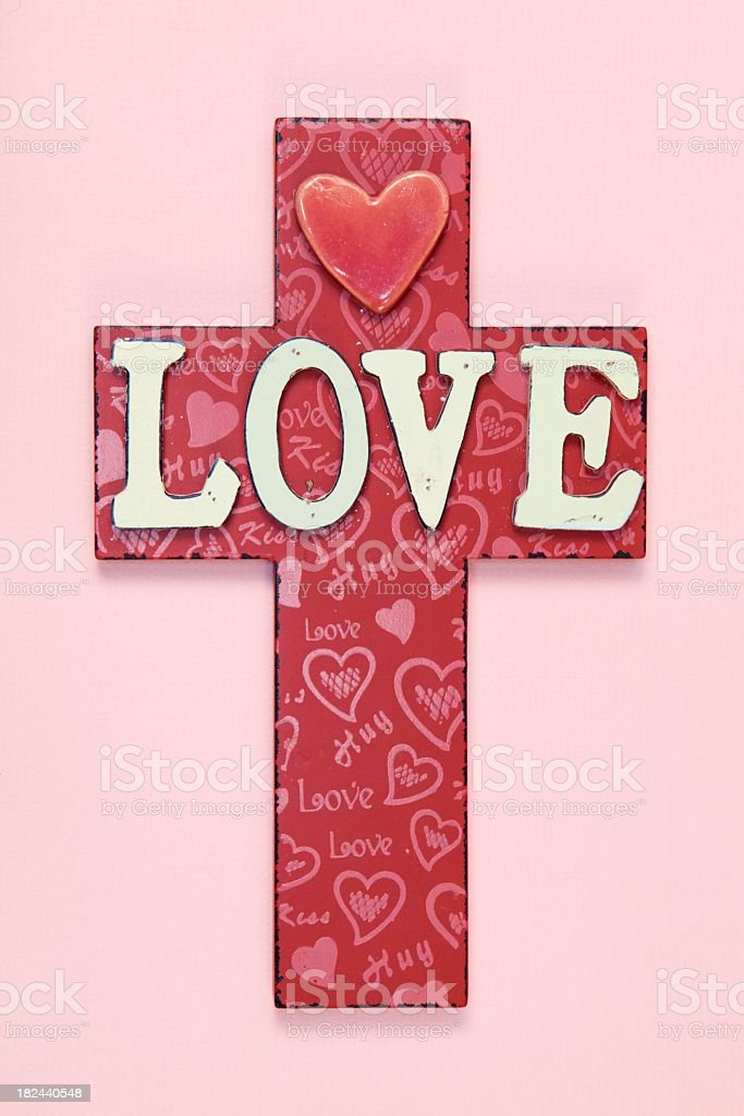 Religious: LOVE Cross on Pink Paper stock photo