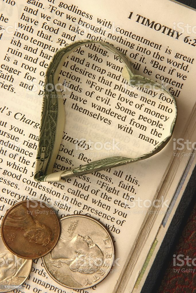 Religious: Love of Money Bible scripture with coins, dollar heart stock photo