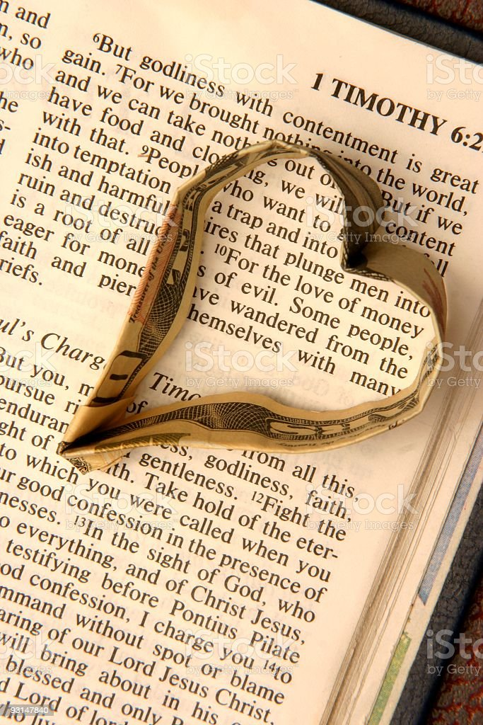 Religious: Love of Money Bible scripture with money heart stock photo