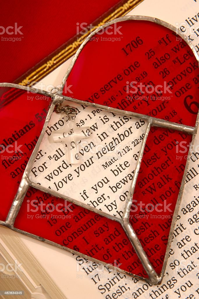 Religious: Love Your Neighbor Bible Scripture with stained glass heart stock photo