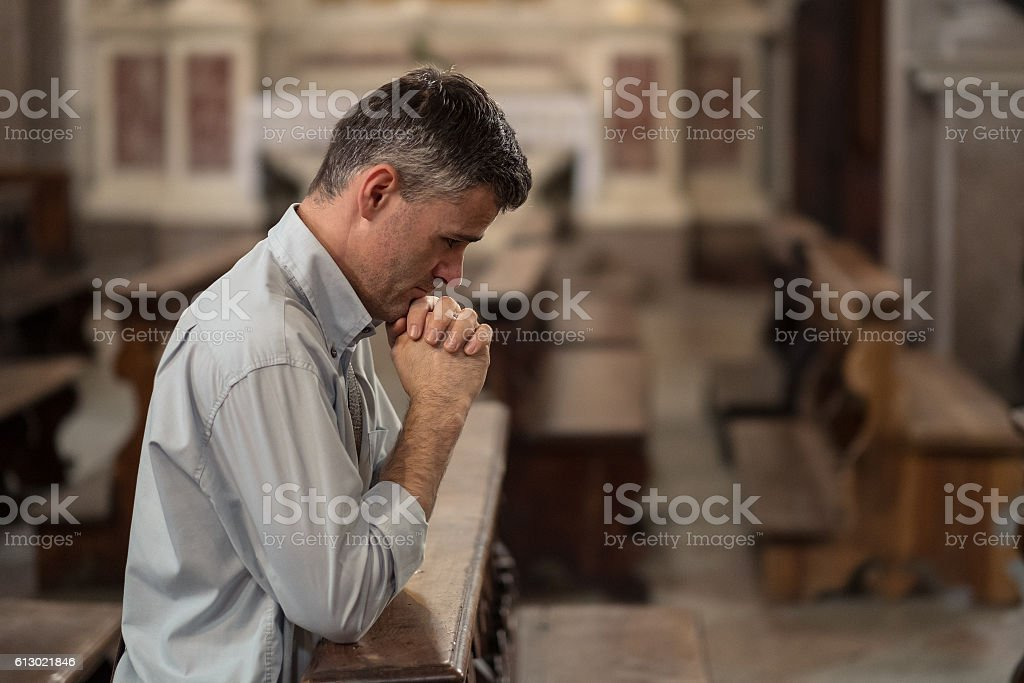 Religious man in the Church stock photo