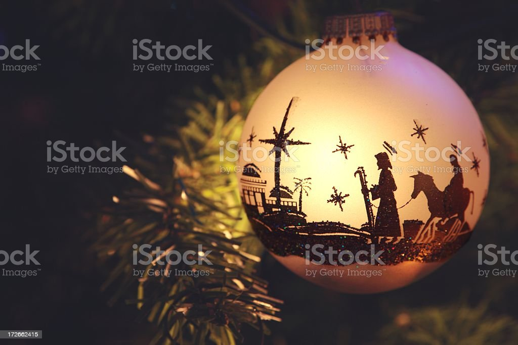 Religious: Nativity Scene silhouette on Christmas Ornament stock photo