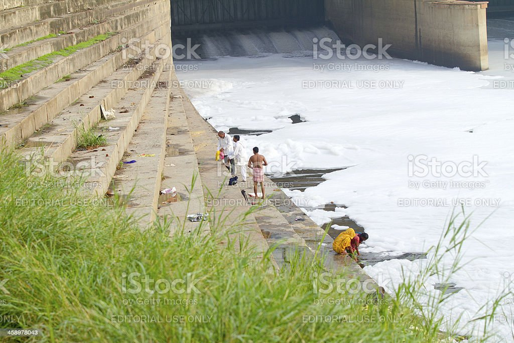 'Religious offerings at the Yamuna River, New Delhi' stock photo