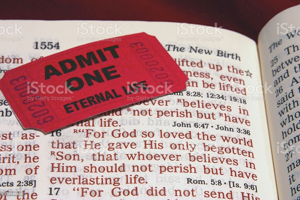 Religious: open Bible Scripture of John 3:16 with ticket royalty-free stock photo
