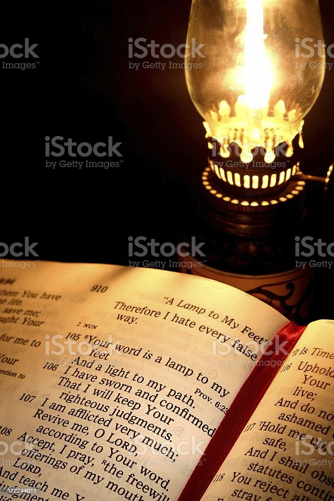 Religious: open Bible showing Scripture and Old Lamp royalty-free stock photo