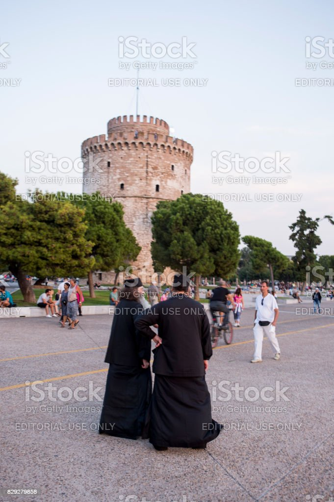 religious priests standing at coast of Thessaloniki greece stock photo