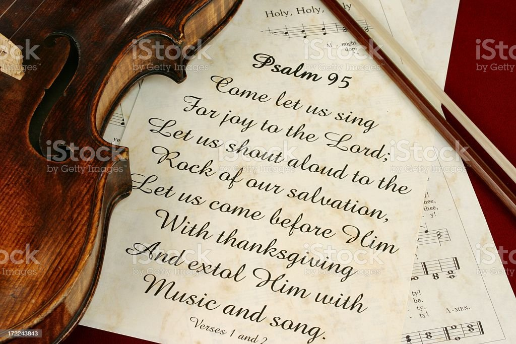 Religious: Psalm 95 scripture with hymns and old violin stock photo