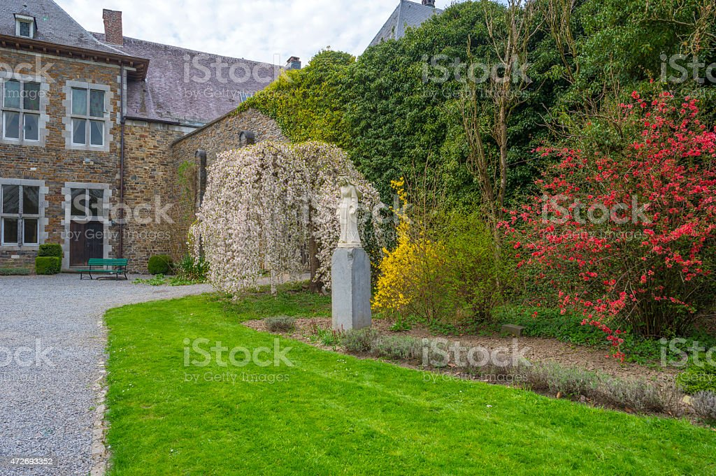 Religious sculpture in a park in spring stock photo