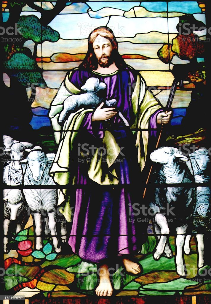 Religious: Stained Glass Jesus the Good Shepherd with 6 toes stock photo