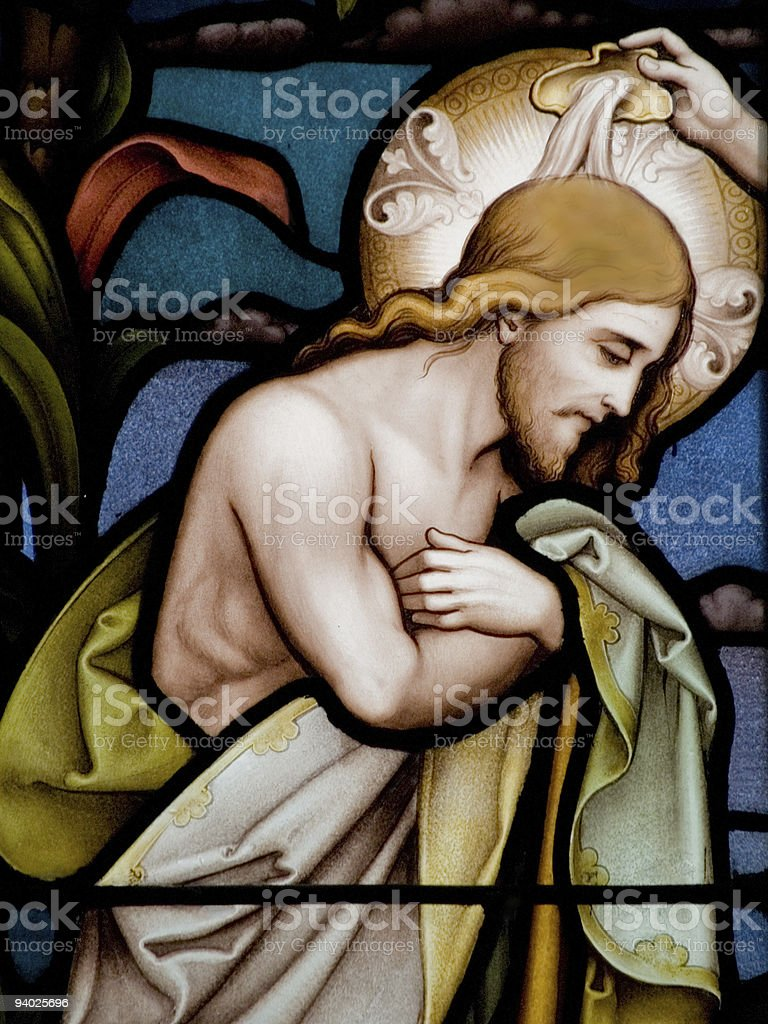 Religious stained glass window depicting a baptism stock photo