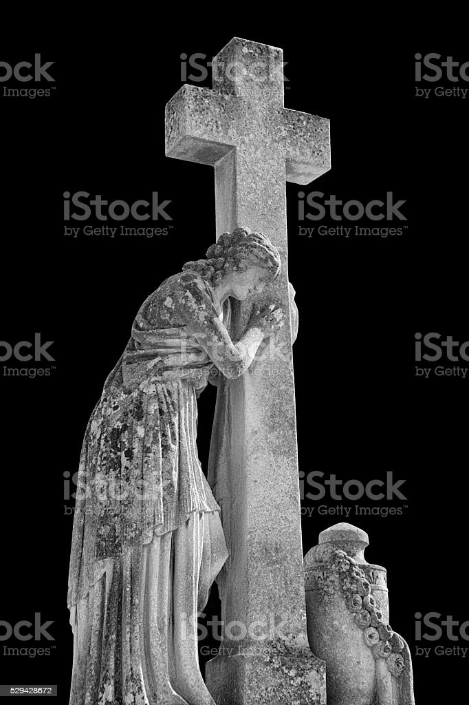 Religious Statue in Lychakiv Cemetery, Lviv, Ukraine stock photo