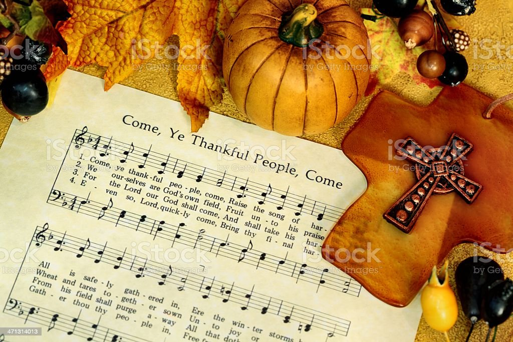 Religious: Thanksgiving Hymn with Cross and Pumpkin royalty-free stock photo