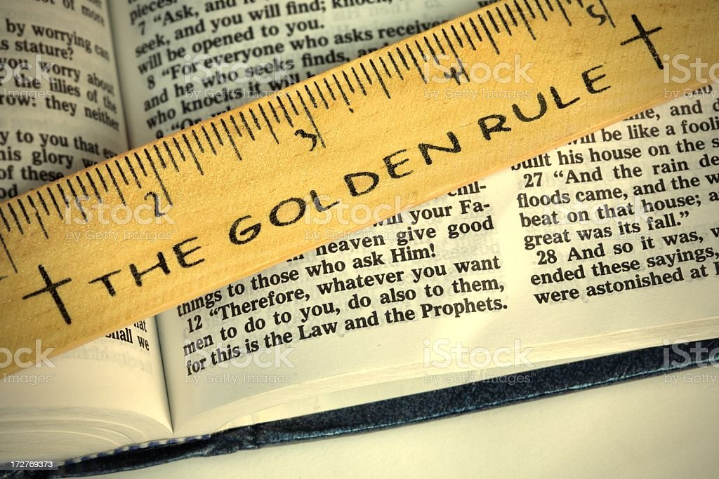 Religious: The Golden Rule on open Bible horizontal stock photo