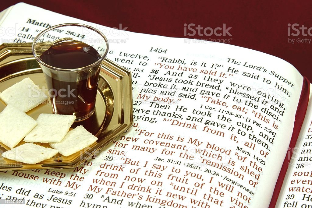 Religious: The Lord's Supper with open Bible stock photo