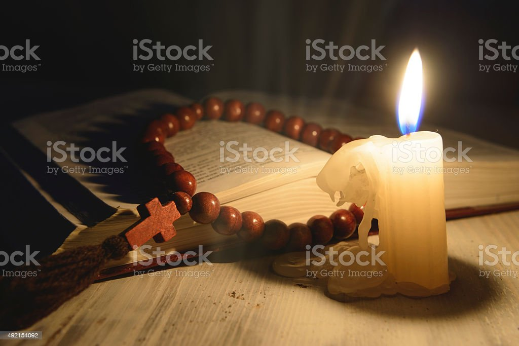 religious theme candle with incense and holy book stock photo