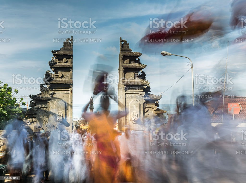 Religious traditional procession in Bali in blur motion stock photo