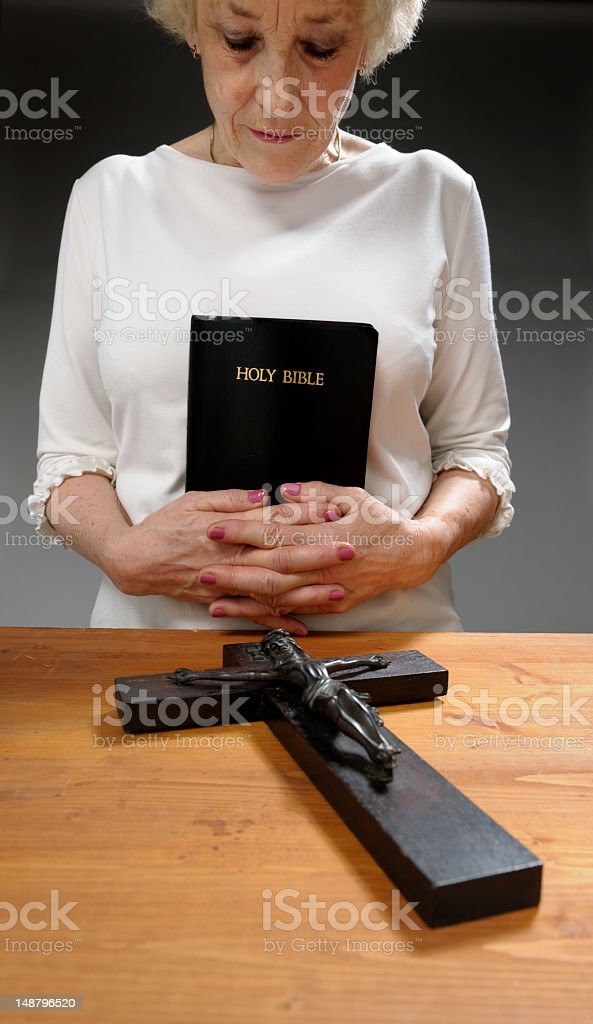 religious woman holding holy bible royalty-free stock photo
