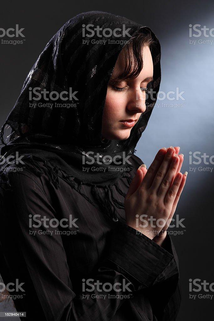 Religious woman meditating in spiritual worship stock photo