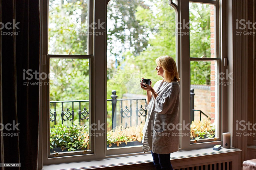 Relishing the morning with a cuppa stock photo