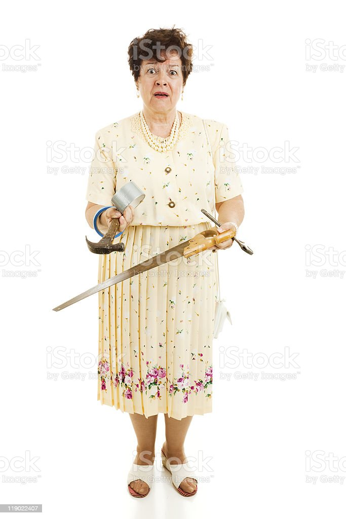 Reluctant Mrs Fixit royalty-free stock photo