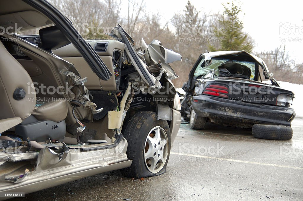 Remaining debris of cars involved in a car crash on road stock photo