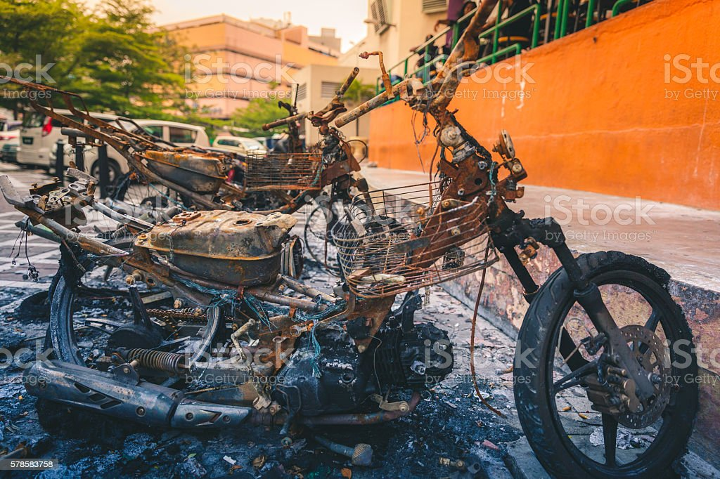 Remains of a burnt motorcycle royalty-free stock photo