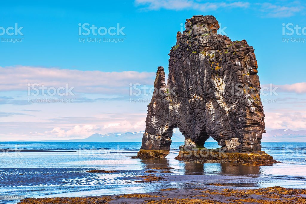 Remains of an ancient cliff Hvitserkur on the sea stock photo
