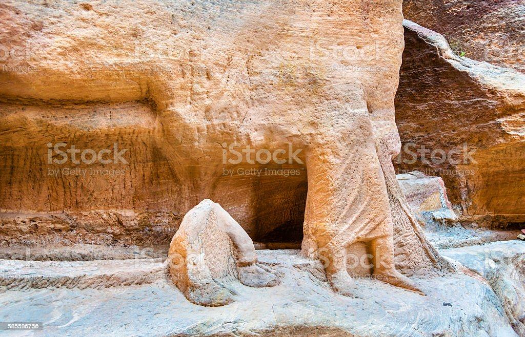 Remains of ancient statues in the Siq at Petra stock photo