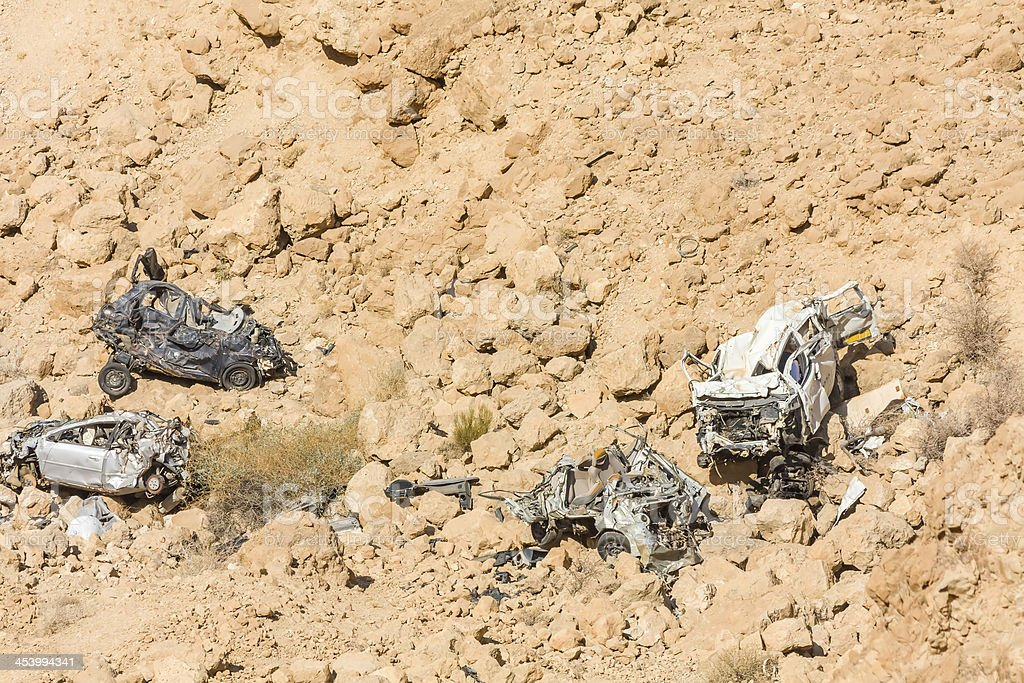 Remains of crashed cars fallen down in abyss royalty-free stock photo