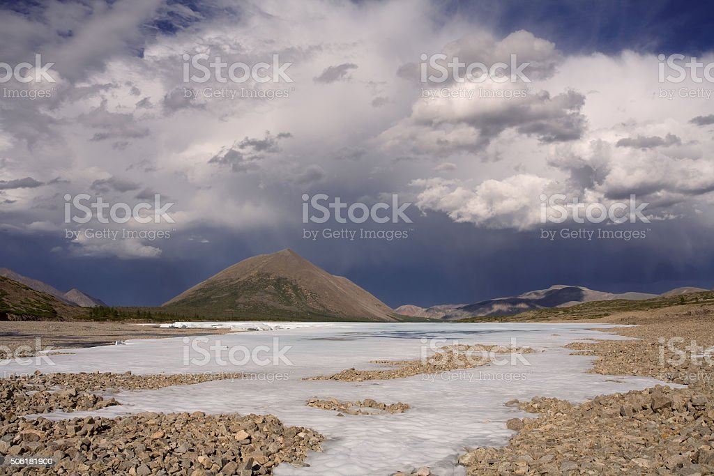 Remains of ice in the valley. stock photo