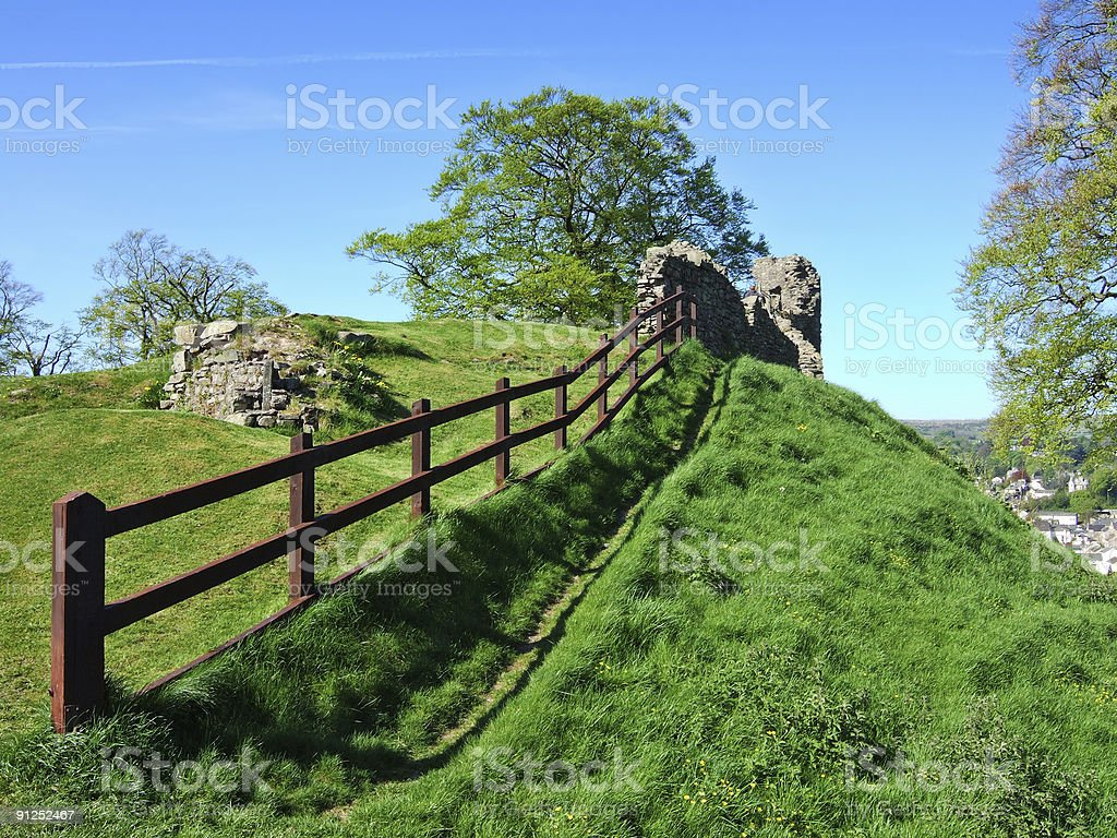 Remains of Kendal castle with wooden fence stock photo