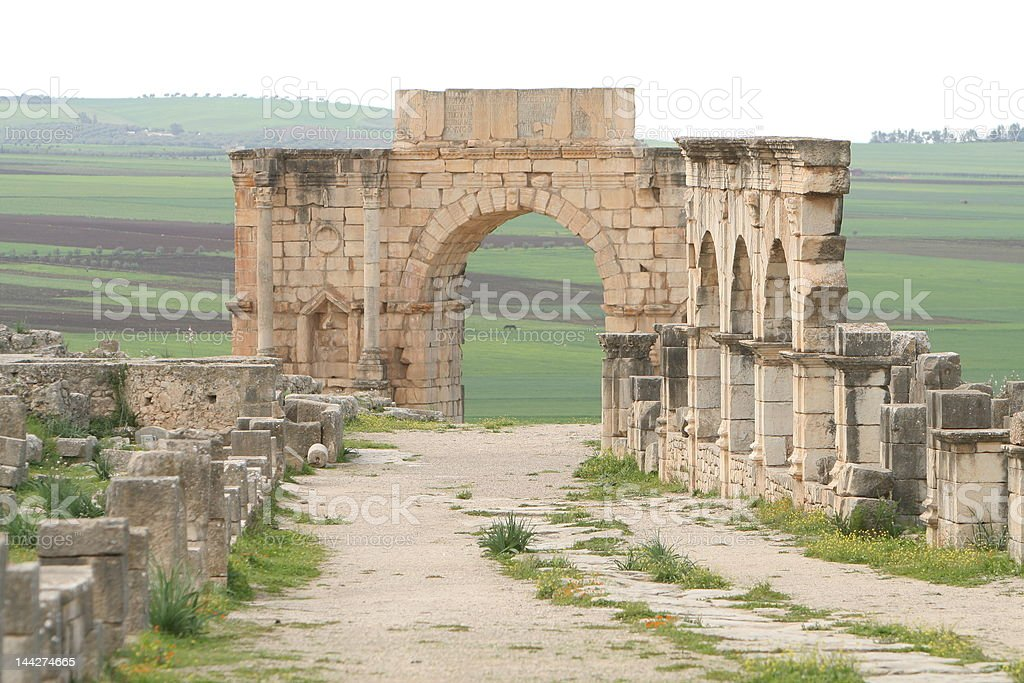 Remains of roman gates in ancient city Volubilis royalty-free stock photo