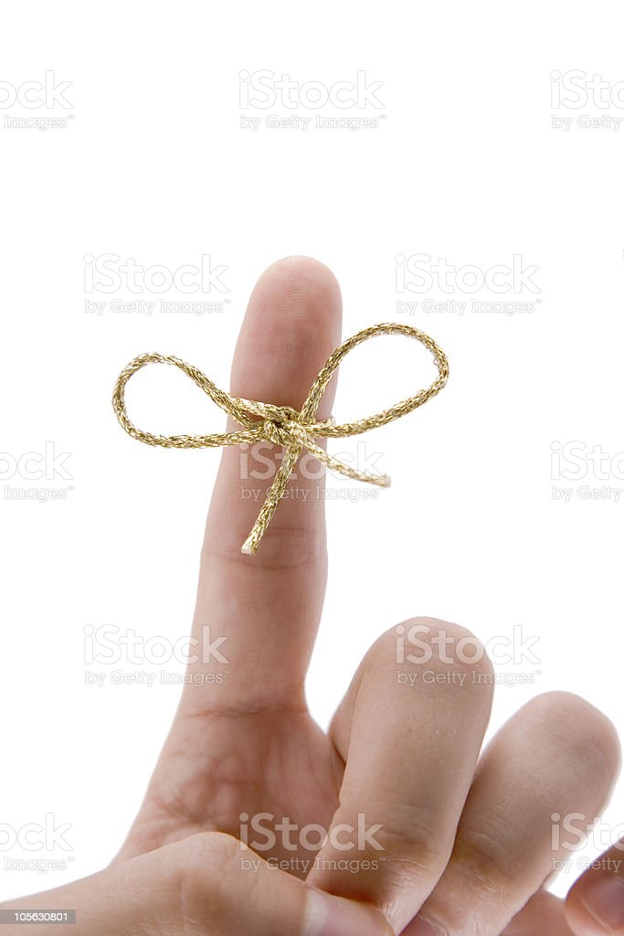 remember concept,  finger with gold tie stock photo