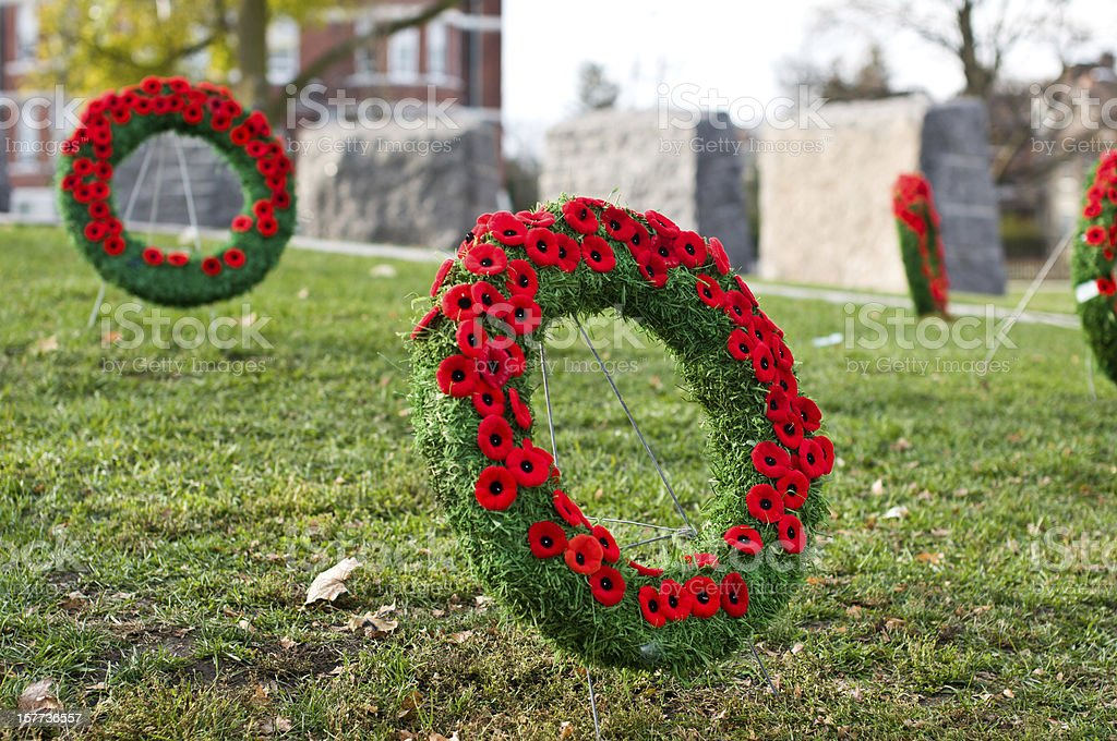 remembrance memorial day bow plaque Wreath poppies grass leafs stock photo