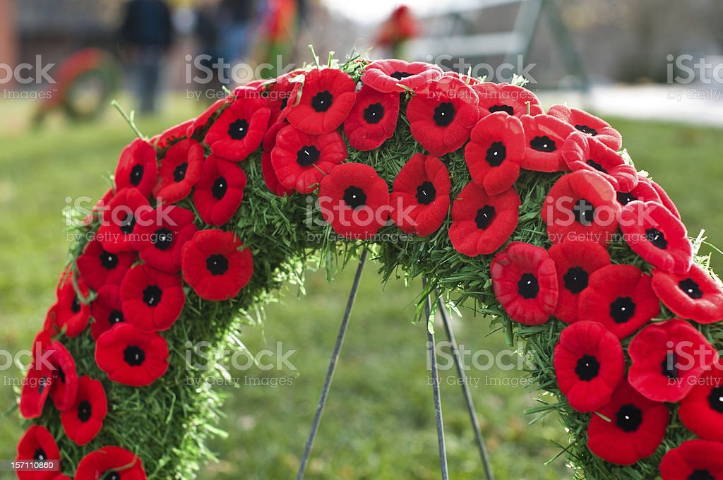remembrance memorial day bow plaque Wreath poppies stock photo
